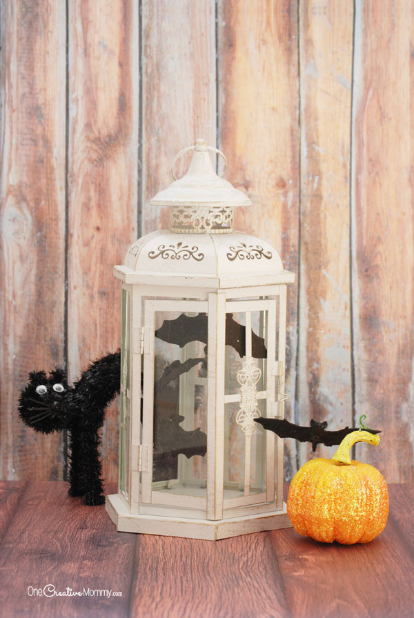 Transform your existing decor to create these spooky and cheap Halloween decorations for only $1! {OneCreativeMommy.com} DIY Bat Aviary