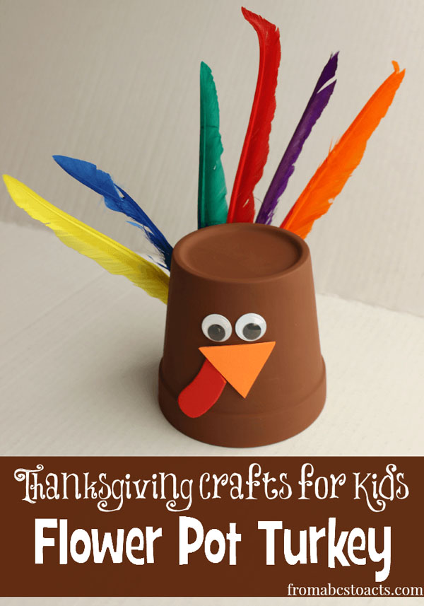 Flower Pot Turkey by From ABCs to ACTs | Featured in the Ultimate Turkey Crafts for Kids Roundup {OneCreativeMommy.com}