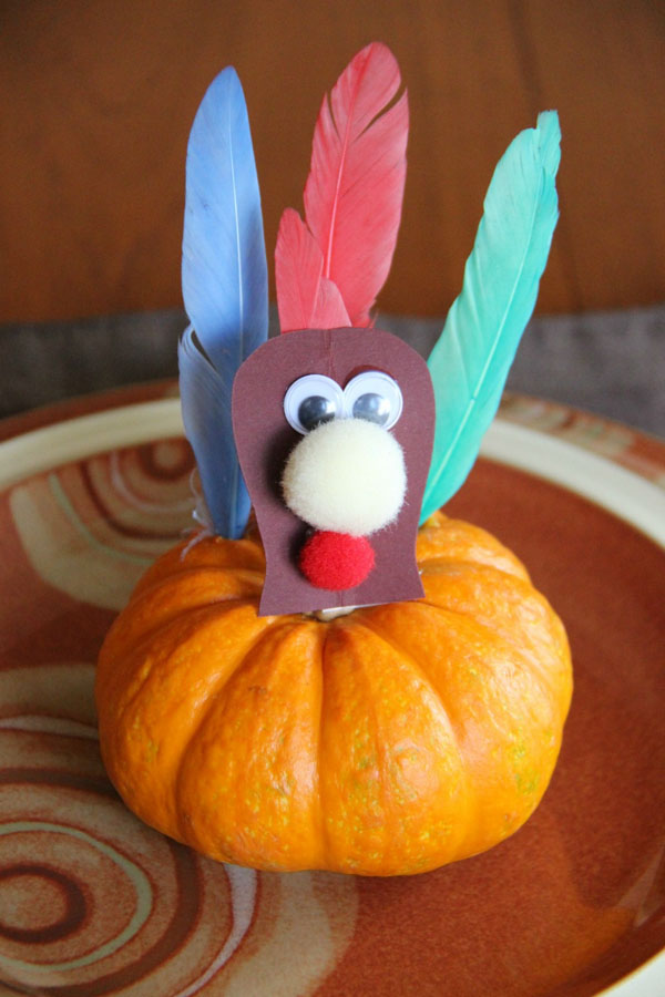 Mini Pumpkin Turkey Craft from Family Food and Travel | Featured in the Ultimate Turkey Crafts for Kids Roundup {OneCreativeMommy.com}