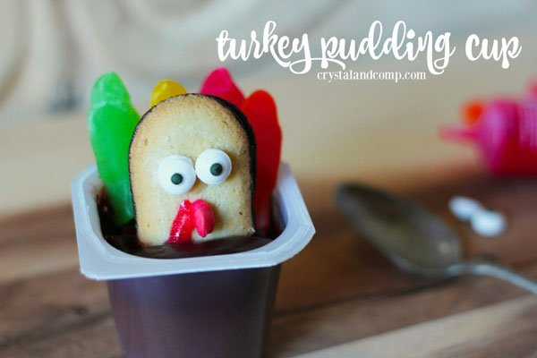 Turkey Pudding Cups Craft from Crystal & Company | Featured in the Ultimate Turkey Crafts for Kids Roundup {OneCreativeMommy.com}