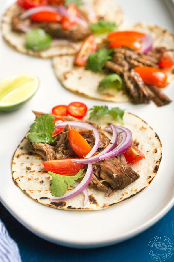 Instant Pot Barbacoa Beef from Gluten Free Pressure Cooker | Featured in Amazing Dairy & Gluten Free Instant Pot Recipes Roundup {OneCreativeMommy.com} #instantpot #dairyfree #glutenfree #pressurecooker