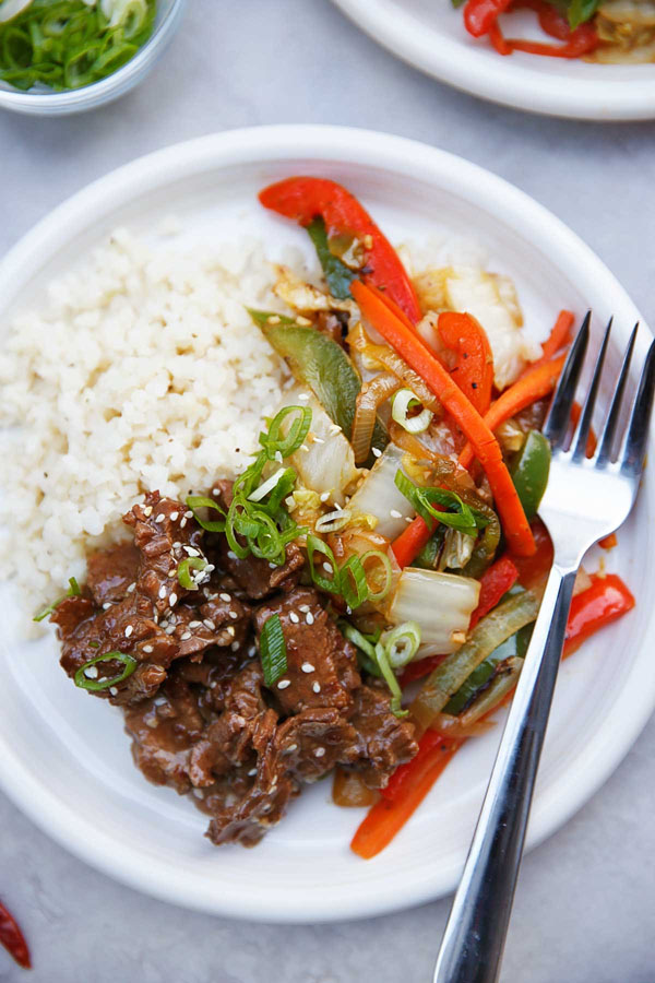 Paleo Mongolian Beef in the Instant Pot from Lexi's Clean Kitchen | Featured in Amazing Dairy & Gluten Free Instant Pot Recipes Roundup {OneCreativeMommy.com} #instantpot #dairyfree #glutenfree #pressurecooker