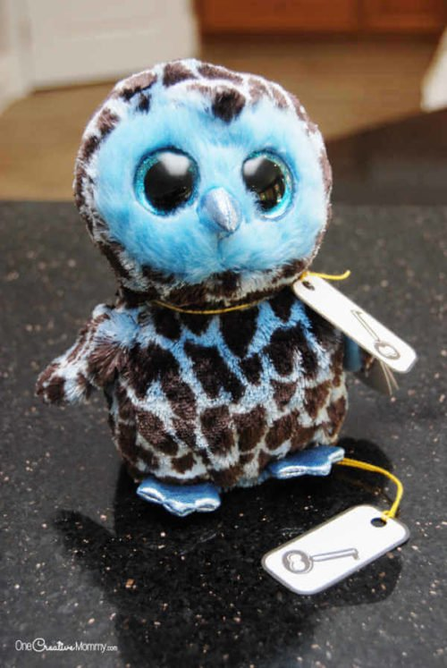 inexpensive stuffed owl with key tied around it's neck